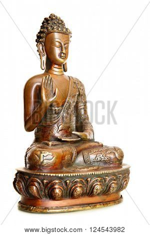Figurine of blessing Buddha isolated over the white background