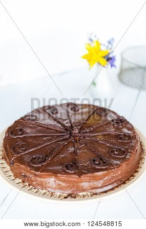Fresh homemade chocolate cake on a white table