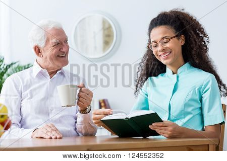 Nurse Helping To Read A Book