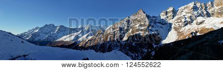 Sunrise in Himalayas big size panorama Nepal. Snowy morning in mountains