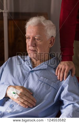 Image of depressed terminally ill senior having care