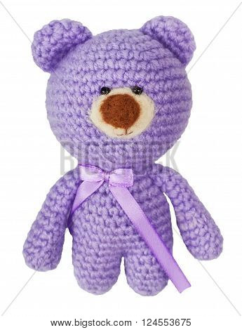 handmade crochet cute lilac bear doll isolated on white background.Crochet toy