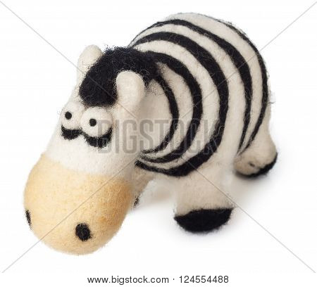 funny handmade toy zebra from felt isolated on white background closeup