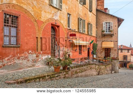 Colorful houses of old town of Saluzzo in Piedmont, Northern Italy.