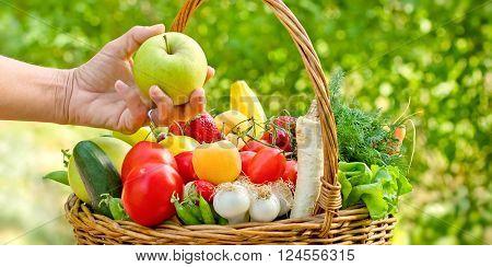 Eating healthy food - healthy diet (eating),  wicker basket is full of fruits and vegetables