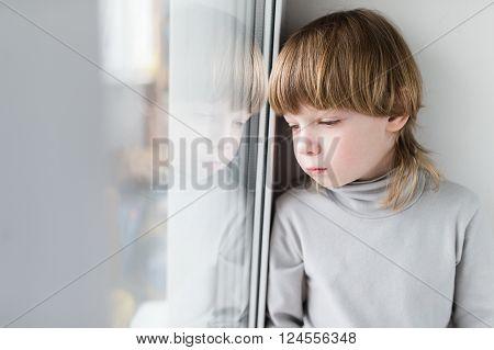 Sad Child Sitting