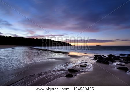 Colorful sunrise along New England coast - Sand Beach, Acadia National Park, Maine