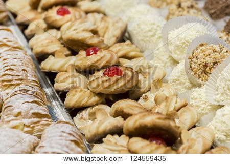 sweet crispy pastry biscuits decorated with cherry