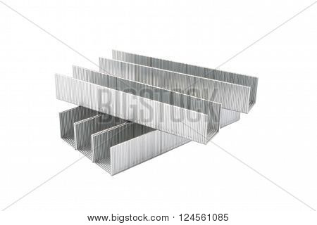 Metal chrome staples isolated on white background