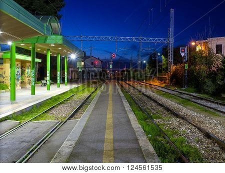 closed evening train station, rails and red light
