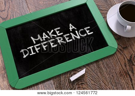 Make a Difference Handwritten by White Chalk on a Blackboard. Composition with Small Green Chalkboard and Cup of Coffee. Top View. 3D Render.