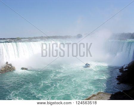 Tourist ship and Canadian Niagara Falls in spring 4 May 2003 Canada