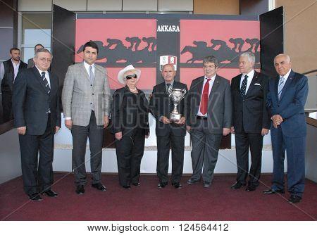 ANKARA/TURKEY-MAY 18, 2013: Mrs. Umran Menderes (3rd left) at the Ankara Hipodrom during the