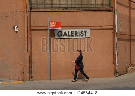 ISTANBUL/TURKEY-OCTOBER 14, 2014: A woman make a walking tour around the Galerist Art Gallery building. October 14, 2014-Istanbul/Turkey