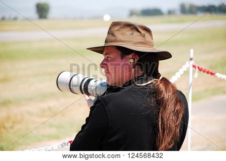 IZMIR/TURKEY-JUNE 5, 2011 : Female photographer at the 2nd Main Jet Base-Cigli for Airshow. June 5, 2011-Izmir/Turkey