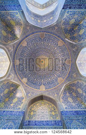 Isfahan, Iran - December 13, 2015: The Shah Mosque  at Naqhsh-e Jahan Square in Isfahan, Iran. Ceiling view