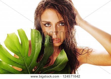 young brunette elegant woman with green leaf isolated on white close up asian face makeup fresh