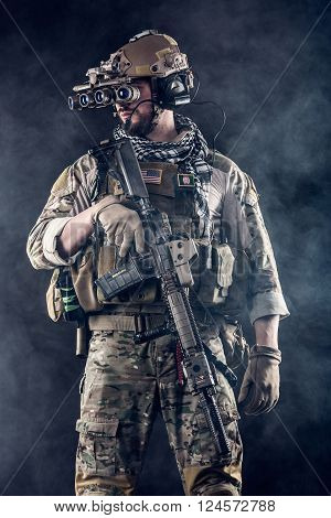 Soldier With Four-eyed Night Vision Goggles In The Smoke