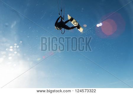 Surfer Flying Through The Sky