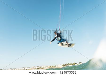 Surfer Flying Through The Sky