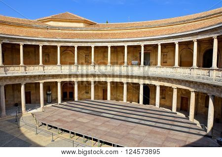 GRANADA - JUN 7: Patio of The Palace of Charles V at the Alhambra, June 7, 2015 in Granada, Spain. The Alhambra is a UNESCO World Heritage Site and is one of the most visited attractions in Spain.