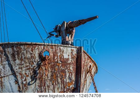 Close-up of harpoon gun on rusty whaler