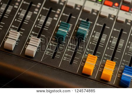 Colored sound mixer bottom with side light ** Note: Shallow depth of field