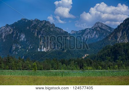Beautiful alpine landscape with meadows and mountains