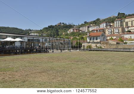 COIMBRA, PORTUGAL - AUGUST 4, 2015: Terrace Bar in the Saint clare the Older Interpretative Centre designed by the architects Alexandre Alves and Sergio Fernandez in the city of Coimbra in Portugal.