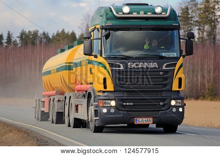 SALO, FINLAND - APRIL 1, 2016: Colorful Scania R500 tank truck for bulk transport trucking along rural highway. Scania celebrates 125 years in 2016.