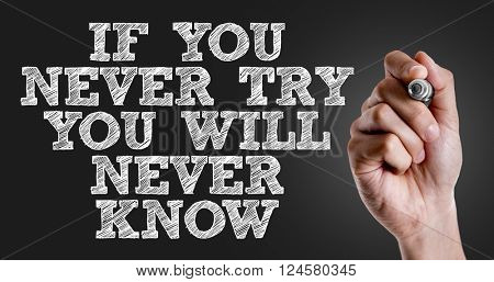 Hand writing the text: If You Never Try You Will Never Know