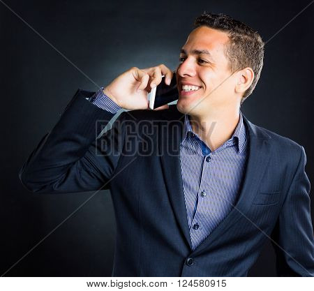business man making a phone deal and smiliing