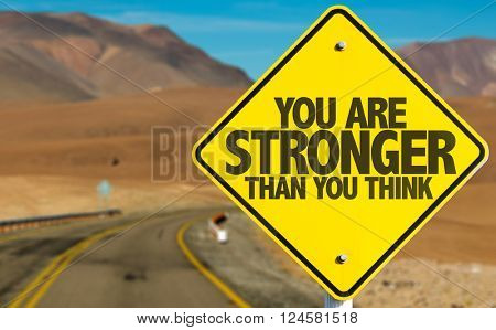 You Are Stronger Than You Think sign on desert road