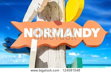 Normandy signpost with beach background