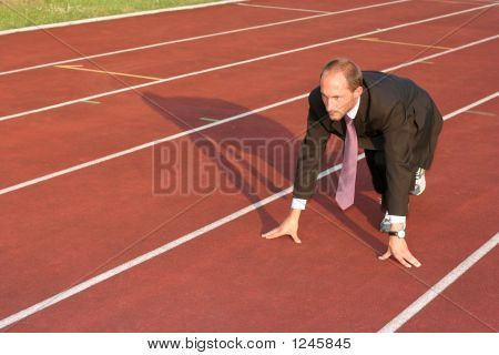 Business Man On A Running Track Ready To Run