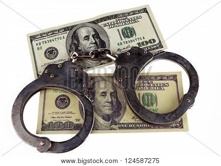 police handcuffs false and real hundred-dollar bill. concept of counterfeiting of money and punishment.