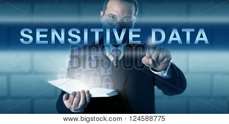 Security director pressing SENSITIVE DATA on a virtual touch screen interface. Business metaphor and information technology concept for confidential information sharing in a protected IT environment.