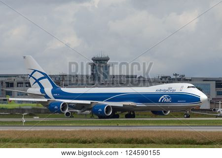 DOMODEDOVO RUSSIA - JULY 20: Aircraft operated by AirBridgeCargo taxiing at Moscow airport in Domodedovo on July 20 2013. The company in its fleet has 4 aircraft Boeing-737-8F