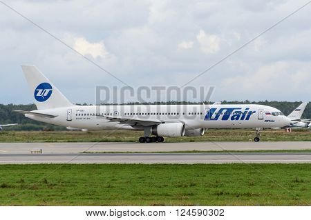 DOMODEDOVO RUSSIA - JULY 20: Aircraft operated by Utair taxiing at Moscow airport in Domodedovo on July 20 2013. The company in its fleet has 9 aircraft Boeing-757-200