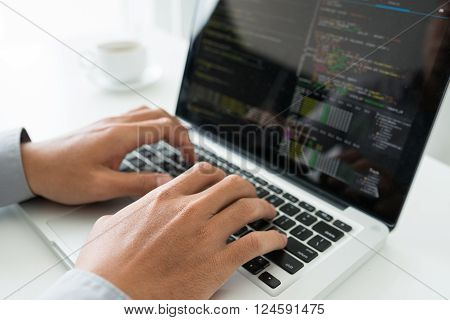 Hands of coder working on new application