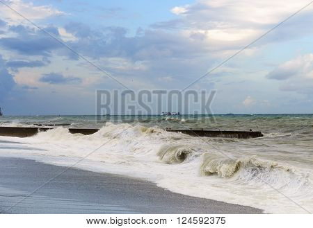 Seafoam and storm waves rolled on shore. ** Note: Visible grain at 100%, best at smaller sizes