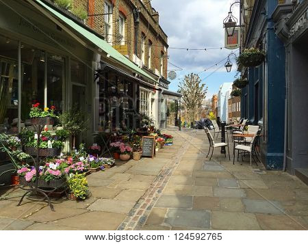 HAMPSTEAD - APRIL 5: Flower Shops and a Pub on Flask Walk on April 5, 2016 in Hampstead, London, UK.
