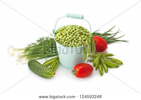 Fresh green vegetables and peas isolated on a white background.