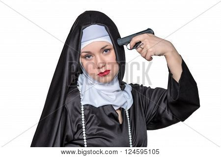 Beautiful nun put a gun to his head isolated on white background
