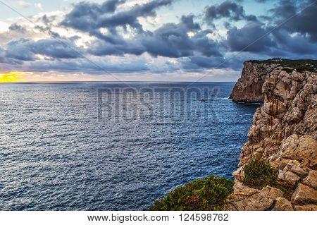 cloudy sky over Capo Caccia coastline, Sardinia