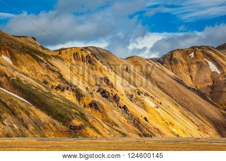 Magnificent Iceland in the summer. Valley National Park Landmannalaugar in the warm sunshine in July
