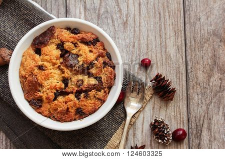 Bread pudding in a white ramekin top view flat lay