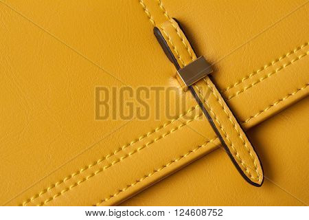 Detail Leather yellow bags close-up, slider, strap, bag texture firmware.