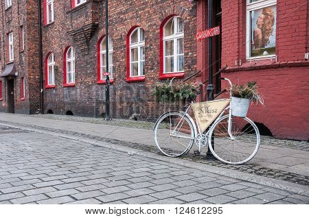 Katowice Poland - March 28 2016: Bike as a signpost in Nikiszowiec historic coal miners settlement built between 1908-1918