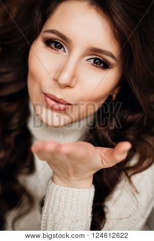 Young pretty hipster girl having fun, going crazy, sending kiss to you , bright make up, fashion vintage outfit